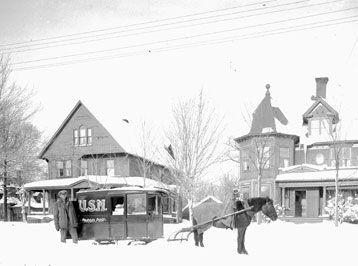A horse drawn mail car on College Avenue, Houghton, 1924