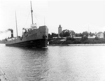 An ore ship leaves Portage Canal